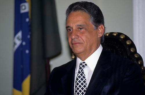 President Fernando Henrique Cardoso of Brazil with the Brazilian flag behind.