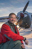 Portrait of Mike Kelly by his airplane, Fairbanks, Alaska.