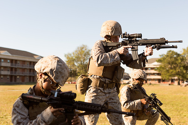 October 22, 2014. Camp LeJeune, North Carolina.<br /> Sgt. Kelly Brown, center, aims a M27 Infantry Automatic Rifle during  patrol training for the 3rd Platoon of the Ground Combat Element Integrated Task Force. Marines in 3rd Platoon of the GCEITF are all considered provisional infantrymen as they have not been to the School of Infantry (SOI) previous to volunteering for the GCEITF.<br />  The Ground Combat Element Integrated Task Force is a battalion level unit created in an effort to assess Marines in a series of physical and medical tests to establish baseline standards as the Corps analyze the best way to possibly integrate female Marines into combat arms occupational specialities, such as infantry personnel, for which they were previously not eligible. The unit will be comprised of approx. 650 Marines in total, with about 400 of those being volunteers, both male and female. <br />  Jeremy M. Lange for the Wall Street Journal<br /> COED
