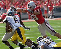 Ohio State linebacker James Laurinaitis (33) dives to make a tackle on Kent State running back Eugene Jarvis (7).  The Ohio State Buckeyes defeated the Kent State Golden Flashes 48-3 on  October 13, 2007 at Ohio Stadium, Columbus, Ohio.