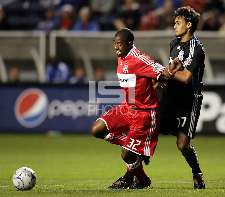San Jose forward Chris Wondolowski (17) holds Chicago defender Dasan Robinson (32).  The Chicago Fire defeated the San Jose Earthquakes 2-0 at Toyota Park in Bridgeview, IL on July 18, 2009.