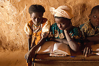Children study in a classroom in the village of Intedeyne. Female literacy rates never reach even 50 percent of male literacy rates. Mali has the highest percentage of people living below the poverty line in any country in the world. /Felix Features
