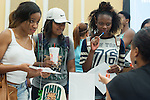 Taylor English, a Jr. Psychology major, Traci Milliner, a junior Pre-Med major, and Britni Walters, a Sociology and Criminology Pre-Law junior ask questions at the Alumni booth during the Multicultural Student Expo and Involvement Fair. Photo by Olivia Wallace