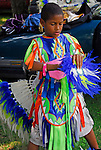 "Native African American boy dressing in pow wow regalia for the Thunderbird Pow-Wow at Queens County Farm Museum. heritage and ethnic pride celebration ..A pow-wow (also powwow or pow wow or pau wau) is a gathering of North America's Native people. The word derives from the Narragansett word powwaw, meaning ""spiritual leader""."