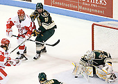 Justin Courtnall (BU - 19), Anders Franzon (Vermont - 27), Rob Madore (Vermont - 29) - The visiting University of Vermont Catamounts tied the Boston University Terriers 3-3 in the opening game of their weekend series at Agganis Arena in Boston, Massachusetts, on Friday, February 25, 2011.