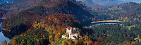 Hohenschwangau castle in with autumn colors on trees, Schwangau, Bavaria, Germany