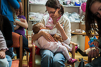 A woman breastfeeding at a support event for breastfeeding mothers.<br /> <br /> 20 June 2011<br /> Hampshire, England, UK