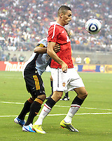 Kevin Alston #30 of the MLS All-Stars holds up Fredrico Macheda #27 of Manchester United during the 2010 MLS All-Star match at Reliant Stadium, on July 28 2010, in Houston, Texas. MANU won 5-2.
