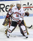 John Muse (Boston College - 1), Dennis McCauley (Northeastern - 12) - The Northeastern University Huskies defeated the Boston College Eagles 2-1 OT in the NU senior night game on Friday, March 6, 2009 at Matthews Arena in Boston, Massachusetts.