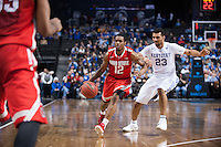 BROOKLYN, NY - Saturday December 19, 2015: A.J. Harris (#12) of Ohio State drives against Jamal Murray (#23) of Kentucky as the two teams square off in the CBS Classic at Barclays Center in Brooklyn, NY.