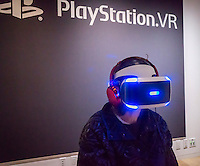 A visitor to Sony Square in New York on Monday, February 27, 2017 tries out the Sony Playstation VR virtual reality headset. The headset, an add-on to existing Playstation 4 consoles, has been very popular due to the existing market of Playstation owners. (© Richard B. Levine)