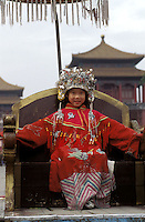 A girl is dressed up in traditional costume of a Chinese empress in the Forbidden City, Beijing, China..18-DEC-02