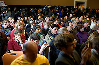 People watch as former senator Rick Santorum speaks at a town hall meeting at Dublin School in Dublin, New Hampshire, on Jan. 6, 2012.  Santorum is seeking the 2012 GOP Republican presidential nomination.  The students are members of a club that worked to invite candidates to visit the school.