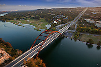 Bird's eye view of Pennybacker 360 bridge overlooking the Austin Country Club Golf Course in Austin Texas