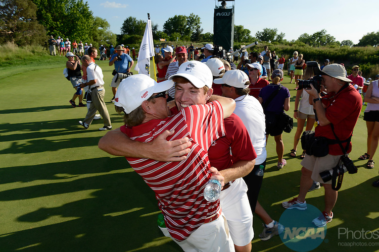 28 MAY 2014: Robby Shelton of the University of Alabama celebrates with teammates and coaches after winning the match play at the 2014 NCAA D1 Men's Golf Championship at Prairie Dunes in Hutchinson, KS. <br /> Evert Nelson/NCAA Photos