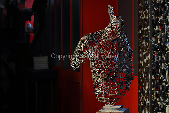 Figurative sculpture of a female torso made from cross-sections of steel tube manipulated into organic profiles and soldered together, in the Soleil Rouge workshop of Nicolas Desbons, metalworker and artist, photographed in 2017, in Montreuil, a suburb of Paris, France. Desbons works mainly in steel but often in conjunction with other materials such as fibreglass, glass and clay, using both cold metal and forge techniques. He produces both figurative and abstract sculptures as well as furniture and lighting. Picture by Manuel Cohen