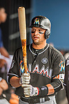 1 March 2017: Miami Marlins infielder Martin Prado holds his bat in the dugout prior to facing the Houston Astros at the Ballpark of the Palm Beaches in West Palm Beach, Florida. The Marlins defeated the Astros 9-5 in Spring Training, Grapefruit League play. Mandatory Credit: Ed Wolfstein Photo *** RAW (NEF) Image File Available ***