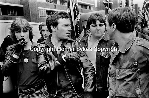 National front members. Lewisham, London.1977. National Front Rules OK pin badge. <br />