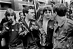 National front members. Lewisham, London.1977. National Front Rules OK pin badge. <br /> Police protect members of the National Front, during the so-called Battle of Lewisham, which took place on 13 August. 500 members of the National Front marched from New Cross to Lewisham, various counter-demonstrations by approximately 4,000 people led to violent clashes between the two groups and between the anti-NF demonstrators and police. 5,000 police officers were present and 56 officers were injured in the riots, 11 of whom were hospitalised. 214 people were arrested for obstructing the police, threatening behaviour, assault, possession of an offensive weapon and throwing missiles. Later disturbances in Lewisham town centre saw the first use of police riot shields on the UK mainland.