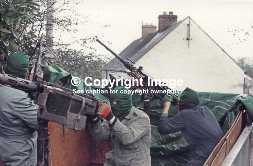This republican movement press release photograph claims to be of a Provisional IRA border unit on manoeuvres in Co Fermanagh, N Ireland, February 1977.  The volunteers are using a 50 mm Browning M2 machine guns. 197702130024g<br />