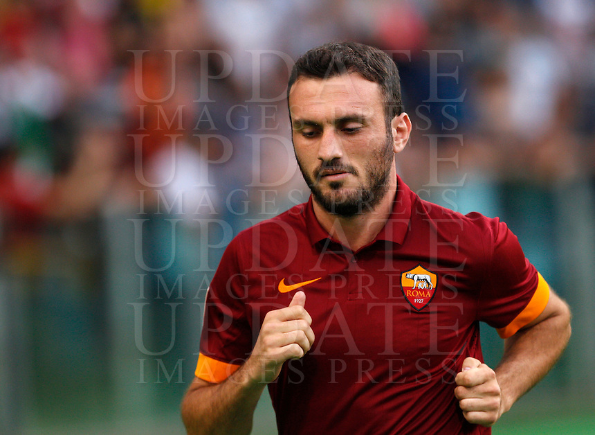 Calcio, amichevole Roma vs Fenerbahce. Roma, stadio Olimpico, 19 agosto 2014.<br /> Roma defender Vasileios Torosidis, of Greece, arrives for the team's presentation, prior to the friendly match between AS Roma and Fenerbahce at Rome's Olympic stadium, 19 August 2014.<br /> UPDATE IMAGES PRESS/Riccardo De Luca