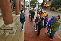 STAFF PHOTO BEN GOFF  @NWABenGoff -- 10/11/14 Rachel Silva with the Arkansas Historic Preservation Program talks about the historic Benton County National Bank building, constructed in 1906, while leading the 'Walk Through History' tour through downtown Bentonville on Saturday October 11, 2014.