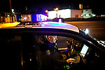 Former Sacramento Police Department robbery detective Darryl Bryan works a traffic stop as a patrol officer on the graveyard shift on  October 26, 2012 in Sacramento, Calif. Budget cuts have decimated the Sacramento Police Department resulting in the elimination of many investigative units.