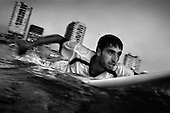 Mohammed Shamalak, 20, paddles out to sea from Gaza City, in the Gaza Strip. Exiting Gaza is a difficult process, especially for males aged 18-40, so surfing offers and important release for those who practise the sport.