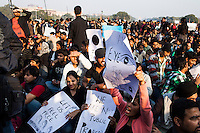 Mass protesters hold up placards and chant their demands for justice and better safety for women after a brutal sexual assault on a young medical student  sparked women, men and youth to take to the streets, fed up with government and police lack of interest in making Delhi a safer place for women, and swarming a long stretch all the way from India Gate to Raisina Hill, at the gates of the Parliament, in Delhi, India on 22nd December 2012. The assaulted medical student was gang raped in a moving bus on 16th December 2012 and violated with an iron rod, and her male chaperone brutally beaten with the same rod. Photo by Suzanne Lee for Marie Claire France