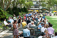Visitors to Bryant Park in New York enjoy their lunch hours on Tuesday, July 24, 2012 (© Richard B. Levine)