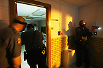 CHAD PILSTER &middot; Hays Daily News<br /> <br /> (left to right) Trooper Adam Medlicott, and Lt. Joe Greene enter a room to search for a subject while Trooper Tod Hileman covers outside on Thursday, April 4, 2013 during a training by troopers with the Kansas State Highway Patrol at Trego Grade School in WaKeeney, Kansas. Troopers were practicing searching a building for a suspect that entered. They recently added high powered weapon mounted flashlights to their arsenal, so this was a chance to train with them.