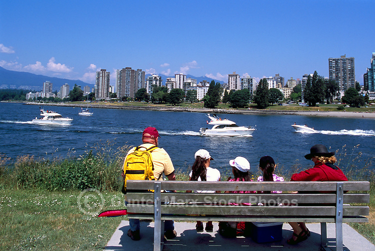 Vancouver, BC, British Columbia, Canada - Family sitting on Bench in Vanier Park and enjoying View of English Bay and West End, Summer