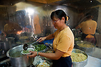 Yan Fong at work in the Shanghai  restaurant kitchen in Chinatown.