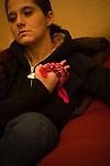 Margaret B. Jones demonstrating the Blood Gang sign in her home in Eugene, Oregon
