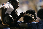 11 September 2015: Virginia's Jake Rozhansky (center) is mobbed by teammates after scoring a goal. The Duke University Blue Devils hosted the University of Virginia Cavaliers at Koskinen Stadium in Durham, NC in a 2015 NCAA Division I Men's Soccer match. The game ended in a 2-2 tie after overtime.