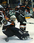 1/5/07 -- Omaha, NE<br />  -- USHL Omaha Lancers Nick Petrecki and goalie Drew Palmisano watch a shot go wide Friday night.<br /> Photo by Chris Machian, Prairie Pixel Group