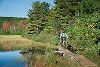 Mountain bikers ride along Lake Manganese outside Copper Harbor Michigan Michigan's Upper Peninsula.