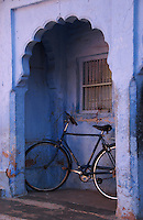 "A bicycle parked in the arched verandah of a traditional house makes an interesting focal point in the ""Blue City"" of Jodhpur, Rajasthan, India."