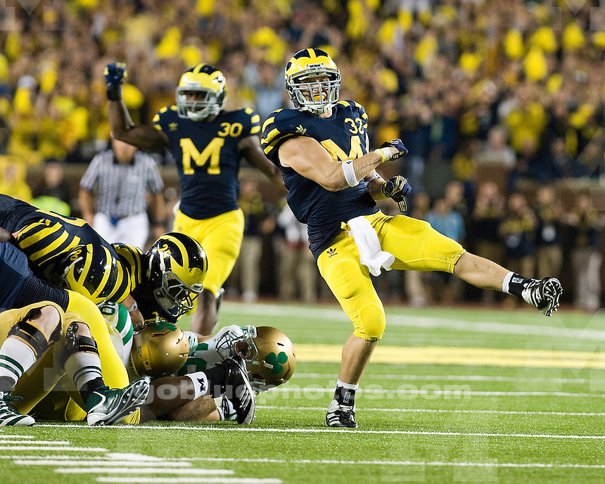 Saturday, September 10th. Michigan's Jordan Kovacs celebrates after the Wolverines stopped Notre Dame short of a first down. Michigan defeats Notre Dame, 35-31, in first ever night game at Michigan Stadium, Satruday night, September 10th, 2011.