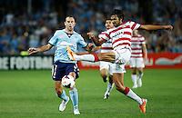 Wanderers Nikolai Topor-Stanley (R) and Sydney FC Richard Garcia during their A-League match in Sydney, March 8, 2014. VIEWPRESS/Daniel Munoz EDITORIAL USE ONLY