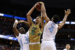 11 March 2016: North Carolina's Isaiah Hicks (4) blocks a shot by Notre Dame's Zach Auguste (30) with help from Joel James (42). The University of North Carolina Tar Heels played the University of Notre Dame Fighting Irish at the Verizon Center in Washington, DC in the Atlantic Coast Conference Men's Basketball Tournament semifinal and a 2015-16 NCAA Division I Men's Basketball game. UNC won the game 78-47.