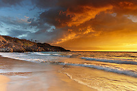 Sunset at Hapuna Beach, Big Island, Hawaii, USA. Volcanic gases and fog, called vog, can create dramatic sunsets.