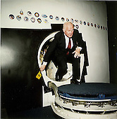 United States Senator John H. Glenn (Democrat of Ohio) egresses a Space Shuttle trainer in the Shuttle mockup and integration facility in Houston, Texas during a tour on April 24, 1989..Credit: NASA via CNP
