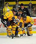 29 December 2007: Quinnipiac University Bobcats' defenseman Jake Bauer (center), a Freshman from Dayton, MN, is helped up from the ice by teammates Dan Henningson (left) and Eric Lampe (right) during a game against the Western Michigan University Broncos at Gutterson Fieldhouse in Burlington, Vermont. The Bobcats defeated the Broncos 2-1 in the first game of the Sheraton/TD Banknorth Catamount Cup Tournament...Mandatory Photo Credit: Ed Wolfstein Photo