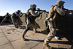 After coming under fire during an ambush of their patrol, Marines with Golf Company 2nd Battalion 5th Marines hunt insurgents, killing several, in Ramadi on January 20, 2005..