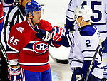 10 April 2010: Montreal Canadiens' left wing forward Andrei Kostitsyn has words with Luke Schenn during the last game of the regular season against the Toronto Maple Leafs at the Bell Centre in Montreal, Quebec, Canada. The Leafs defeated the Habs 4-3 in sudden death overtime as the Canadiens advance to the Stanley Cup Playoffs with the single point. Mandatory Credit: Ed Wolfstein Photo