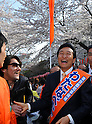 April 7, 2011, Tokyo, Japan - Miki Watanabe, a candidate running for governor of Tokyo, breaks up as he shakes hands with partygoers in his campaign at Tokyo's Ueno Park, where some 1,200 cherry blossoms are in full bloom on Thursday, April 7, 2011. Watanabe, the founder of a chain of casual pubs, is running in the April 10 Tokyo gubernatorial election, attempting to make the big jump from business manager to big-time politician. (Photo by AFLO) [3609] -mis-.