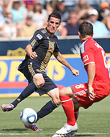 Sebastien Le Toux #9 of the Philadelphia Union battles Dan Gargan #8 of Toronto FC for a loose ball during an MLS match at PPL stadium in Chester, PA. on July 17 2010. Union won 2-1 with a last minute penalty kick goal.