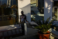 Port Au Prince, Haiti, Jan 21 2010.A music artist in the ruins of the Ministry of Culture..
