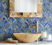 Margot, a jewel glass waterjet mosaic, is shown in Blue Onyx.
